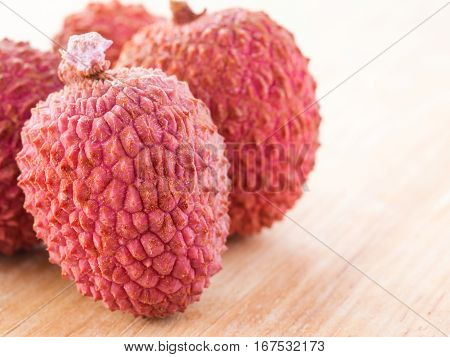 lichee fruit on wooden background close up