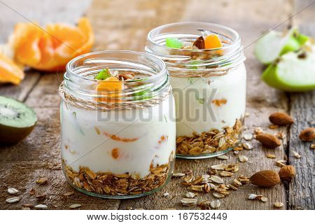 Delicious healthy American breakfast made of granola yogurt and fruits. Classic US morning meal. Traditional healthy snack. Close-up shot.