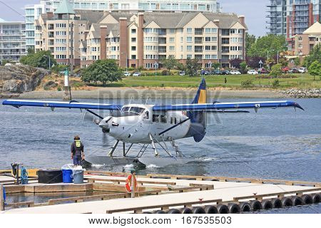 Seaplane taxiing to approach its berth in Victoria harbour