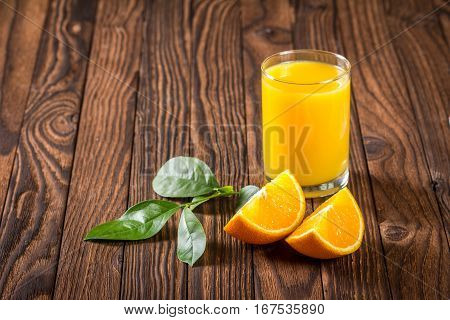 Glass Of Juice And Orange Slices On A Table