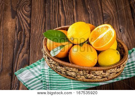 Oranges And Lemons In The Basket On The Table