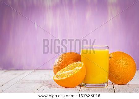 Glass Of Fresh Juice And Sliced Orange