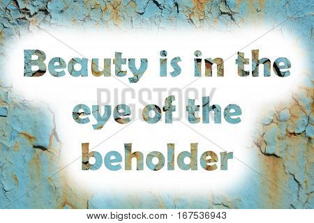 Beauty Is In The Eye Of The Beholder. Words Print On The Grunge Metallic Wall