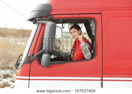 Young woman driving big truck