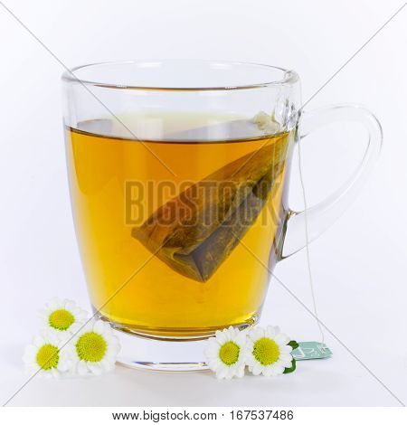 hot camomile tea with camomile flowers in cup
