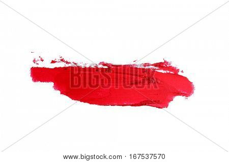 Smudged lipstick on white background