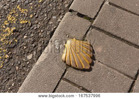 Saint James way shell golden metal on streets soil stone floorNajera La Rioja Spain