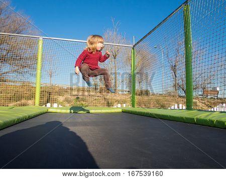 Little Kid Jumping On Trampoline