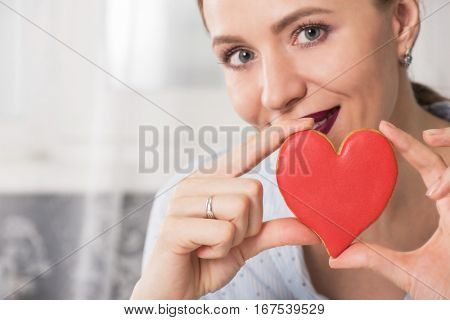 Young woman with gingerbread heart cookies. Illustrate of Happy Valentines Day or Mother day.