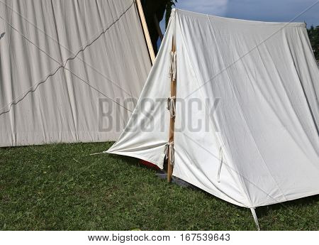 white tents in a scout camp in summer