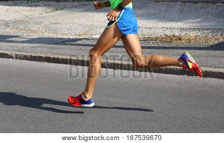 Runner During A Running Race On Paved Roads In The City