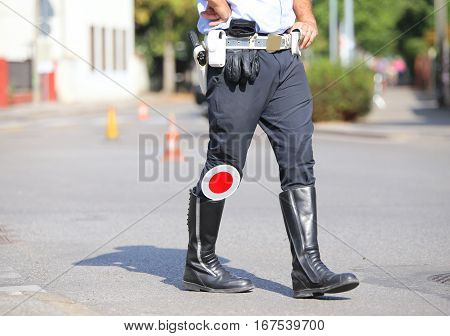 Black Boots And Traffic Pallet Of A Traffic Policeman In The Cit