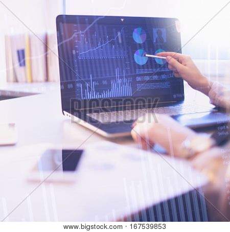 Business people abstract background concept. Woman pointing to computer screen with sale statistics