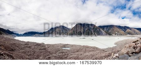 Tasman glacial lake under the Mt. Cook and Southern Alps. New Zealand. Panoramic photo