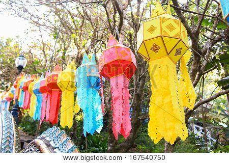 Line of Colorful Asian Lanna Style Paper Lamps in Chiang Mai Thailand