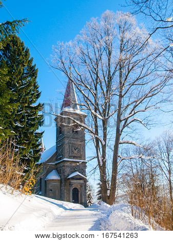 Rural church in rococo architectural style in winter time, Horni Tanvald, Northern Bohemia, Czech Republic, Europe.