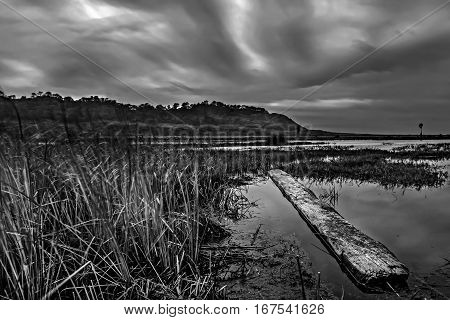 A stormy lagoon at Carmel Valley, San Diego, California is captured in black and white