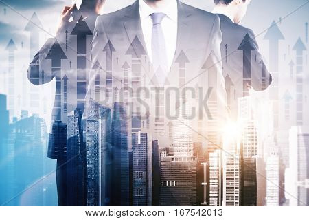 Businessmen on abstract city with arrows background. They are thinking about financial growth. Double exposure