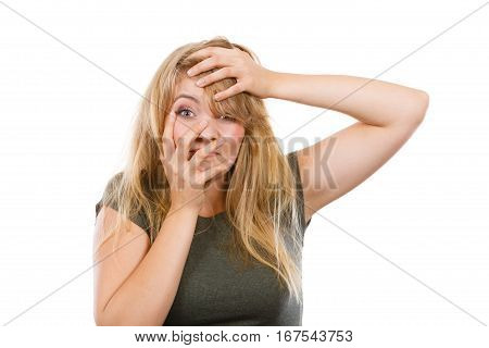 Emotions embarrassment awkwardness gestures concept. Ashamed blonde woman making facepalm placing hand on her forehead. Studio shot on white background.