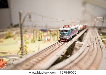 Moving model train in a scale landscape