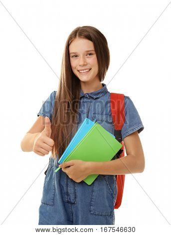 Cute teenager girl holding notebooks on white background