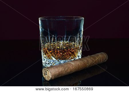 Glass of whiskey and a big cigar.