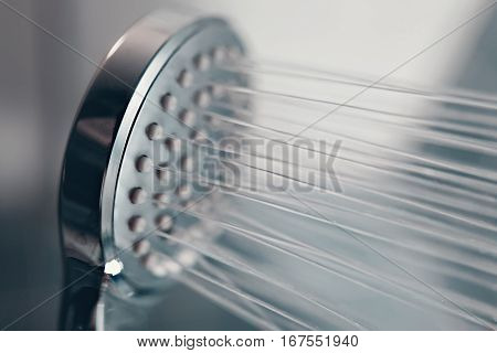 Shower Head With Flow Of Water Spilling Out Closeup.