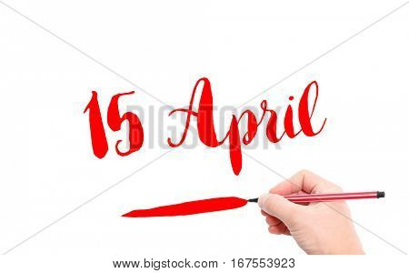15 April written by hand on a white background