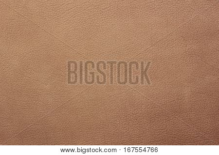 Light brown leather texture closeup background. Structured background design nubuk
