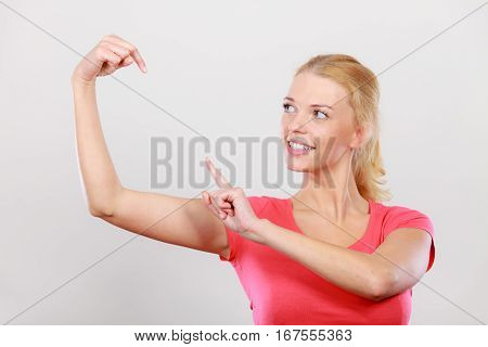 Happy Woman Pointing On Left Side