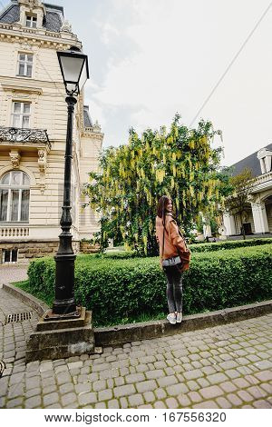 Stylish Gorgeous Hipster Girl Traveling In Europe City In Sunny Spring Time