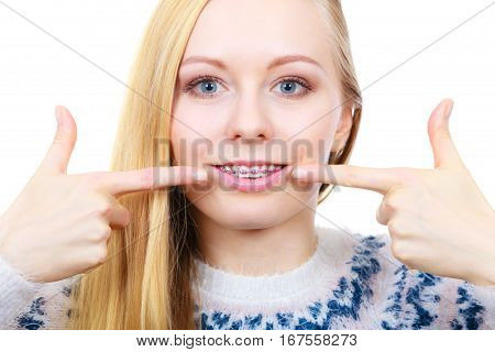 Happy Woman Showing Her Braces On Teeth