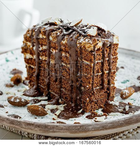 Delicious sweet chocolate Spartak cake on a rustic plate. Haute cuisine dessert with cup of coffee. International food.