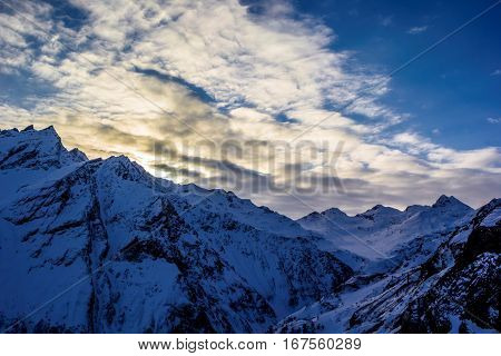 the cloudy sky over snow mountains, a winter landscape, the nature of the North Caucasus