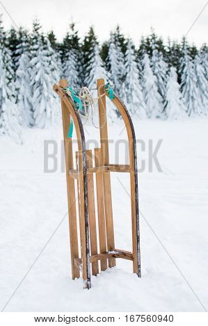 Wooden Sleds On Snowy Mountain