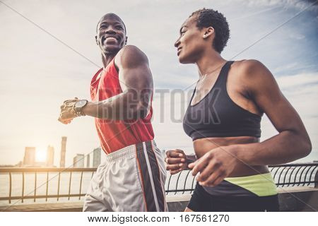 Couple running in New York - Sportive man and woman training outdoors