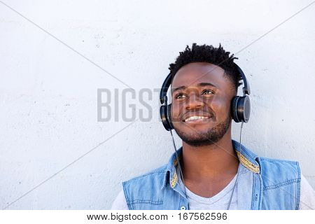 Smiling Black Man Listening To Music With Headphones