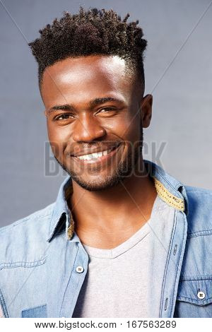 Handsome Smiling Black Man Standing By Gray Background