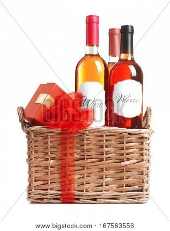 St. Valentines Day concept. Wine bottles and gift box in basket isolated on white