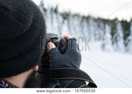 Photographer Taking Picture On A Winter Day