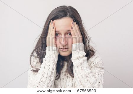 Girl Confused Grasping Hands Head. Coming Up With The Problem Solution