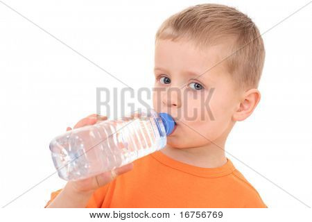4 years old boy with bottle of water isolated on white