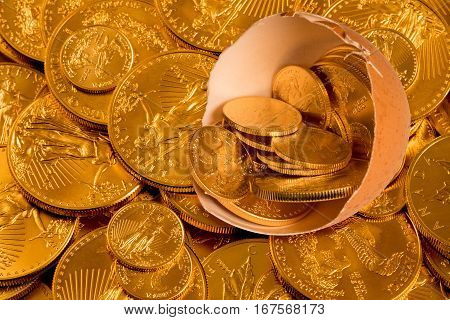 Gold coins from USA treasury in a broken egg shell as nest egg illustration against a golden background of other coins