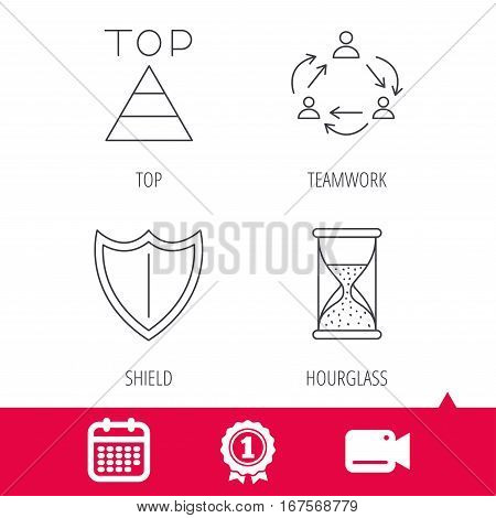 Achievement and video cam signs. Teamwork, shield and top pyramid icons. Hourglass linear sign. Calendar icon. Vector