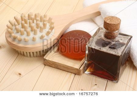 glycerin soap bottle of massage oil and towels
