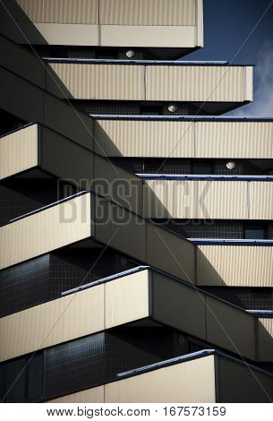 Unusual facade of the building. Beautiful shot of the modern architecture with acute angels on the facade.