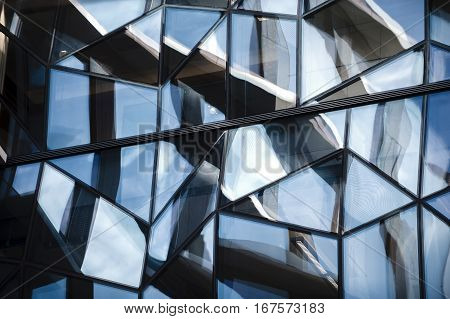 Abstract detailed shot of reflecting glass wall of the office building.