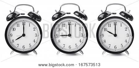 Time change concept. Alarm clocks on white background