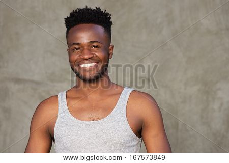 Handsome Muscular Man Standing And Smiling