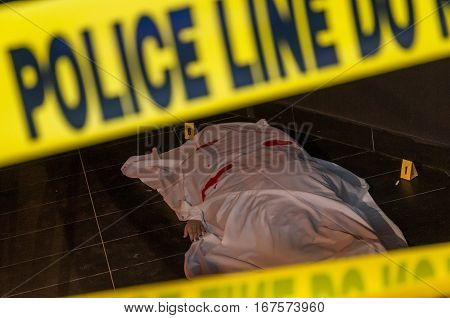 A Body On The Ground Of A Crime Scene